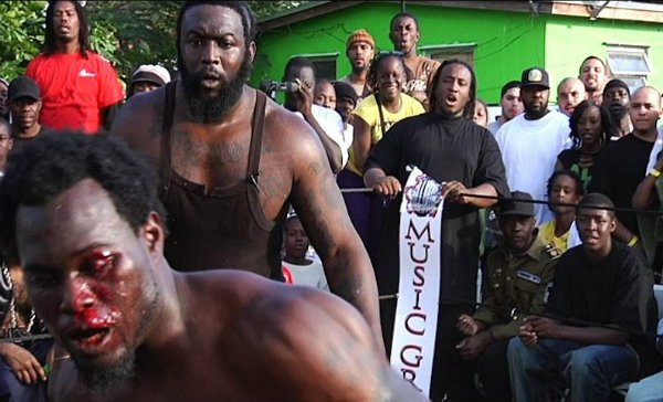 Dada 5000 refereeing a bare-knuckled backyard bout during the filming of Dawg Fight. | Photo: Rakontur